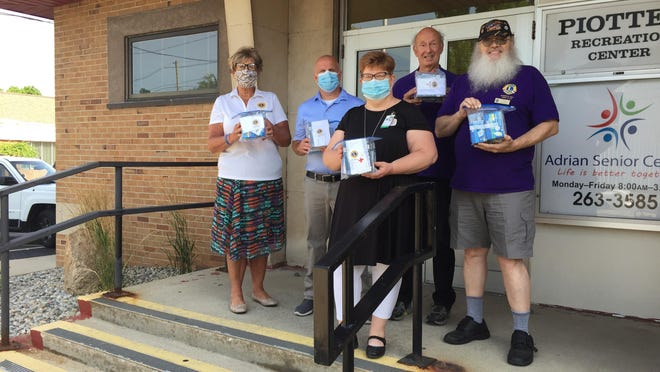 On July 15, 30 glucometers and diabetes testing kits were donated to the Family Medical Center of Michigan in Adrian by the Blissfield Area Lions Club. The Lions Club presentation and donation took place at the Adrian Senior Center. Pictured from left, are, Lions International Vice District Gov. Terri Huffman, Family Medical Center administrator Chris Risling, Lenawee County Department on Aging Director Cari Rebottaro, and Blissfield Lions Club members Dick Saxton and Russell Quinton.