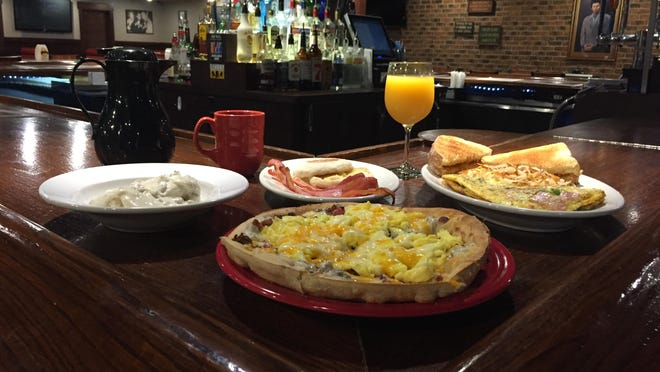Several of Village Inn's newest breakfast dishes. The menu includes traditional offerings like eggs, toast and potatoes. Customers can also order breakfast burritos, tacos and -- of course -- pizza.