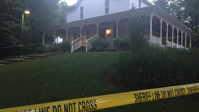 The Weaver House in West Olive is blocked by police tape after a deck collapse on June 15, 2017. Michigan Court of Appeals judges have reversed a decision to dismiss a pair of lawsuits over the deck's collapse.