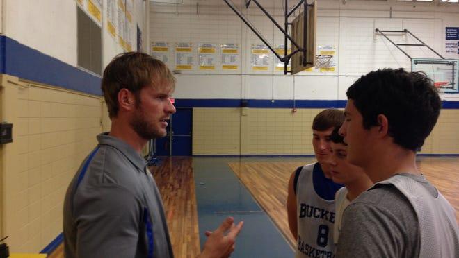 Morey Skluzacek, the new Buckeye boys basketball coach, talks with some players before practice Wednesday.