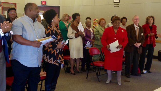 Members of Cenla Retired Teachers Association Inc. and the community clap and stand for Willie Belle Franklin (front right, in red) at its annual founders celebration on Thursday. The organization chooses an honoree each year. Franklin was a teacher and administrator for 34 years in Rapides Parish.