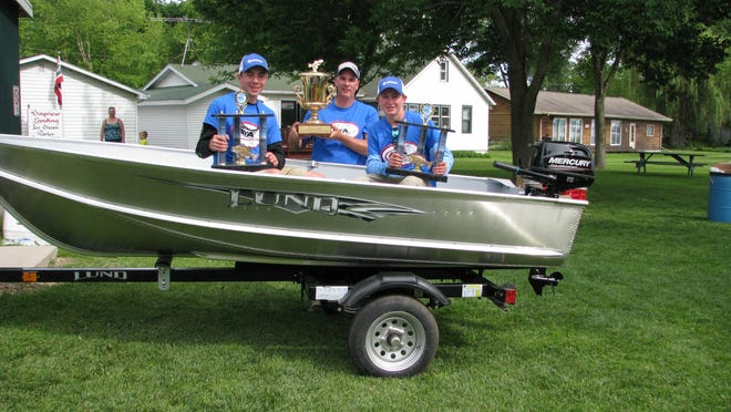 The first place team of Rich and Bailey Bleser and Will Buhler on June 14, 2014 at the Green Lake Regional AYA Fishing Tournament.