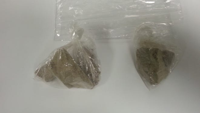 The drug enforcement unit seized 73 grams of heroin from a Grand Chute hotel room.