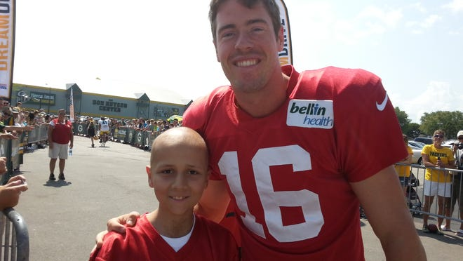 Jaxson Hinkens, 11, surprised his friend, Packers quarterback Scott Tolzien, at training camp this summer.