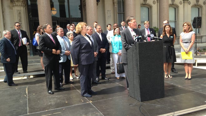 Tom Bracken, president and chief executive officer of the New Jersey State Chamber of Commerce, criticizes proposals from Democratic lawmakers to raise income and corporate taxes in a June 24, 2014 news conference in front of the Statehouse in Trenton, N.J.