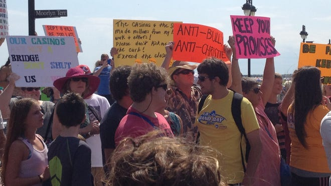 Protesters wait to greet Gov. Chris Christie at a town hall Thursday in Ocean City on Thursday.  .