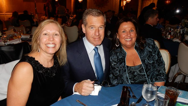 NBC news anchor Brian Williams, center, attended a fundraising gala last weekend and donated $50,000 to help save his alma mater.