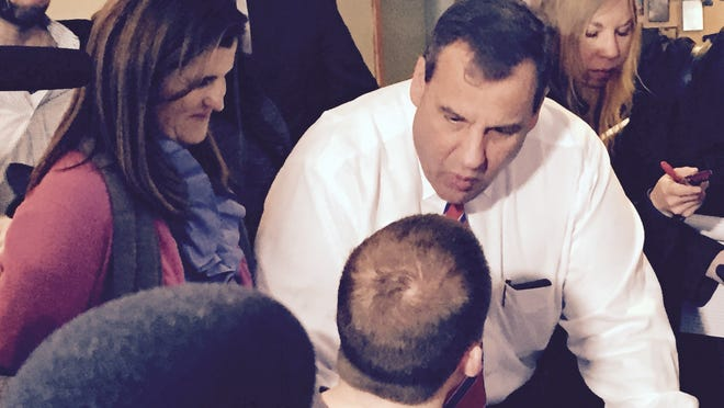 Gov. Chris Christie (right) and his wife Mary Pat meet diners at a Manchester, New Hampshire breakfast spot Wednesday before Christie was scheduled to host a town hall (Bob Jordan iPhone photograph)