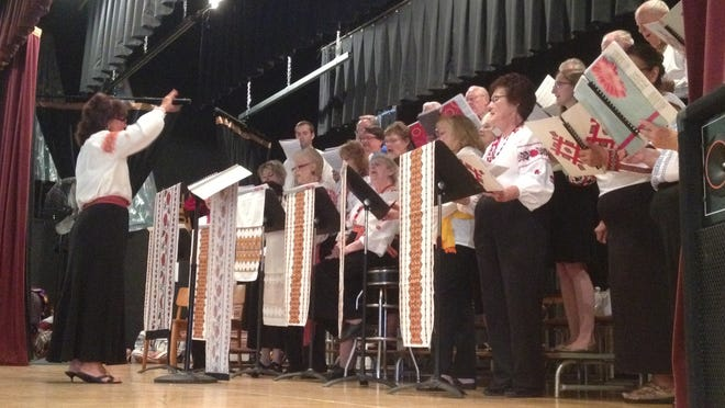 The St. John's Ukrainian Orthodox Church is hosting its 87th Ukrainian Days festival this weekend. Here, the church's choir sings to a crowded church hall on Saturday.