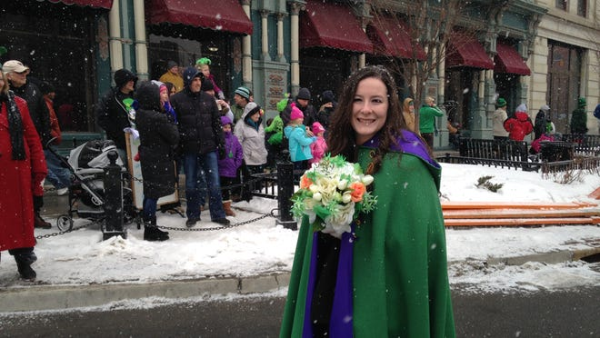 Maid of Erin Tess Hatton of Binghamton was among those who smiled and waved at bystanders watching the parade.