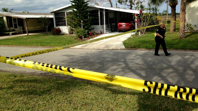 Crime scene tape cordons off the Barefoot Bay home of Doris Johnston in this January file photo.