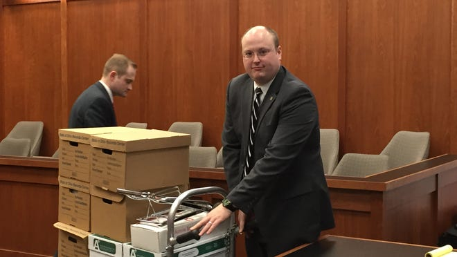 Lead state prosecutor Samuel Kirk wheels out a cart loaded with evidence against Kendall Clemons at the end of the trial in which a jury awarded $6.41 million in damages.