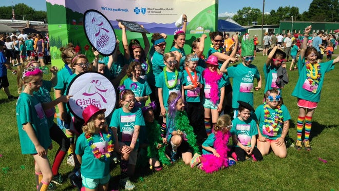 Girls on the Run Vermont participants ham it up for pictures in a photo booth provided by GOTRVT's statewide program sponsor, BlueCross BlueShield of Vermont.
