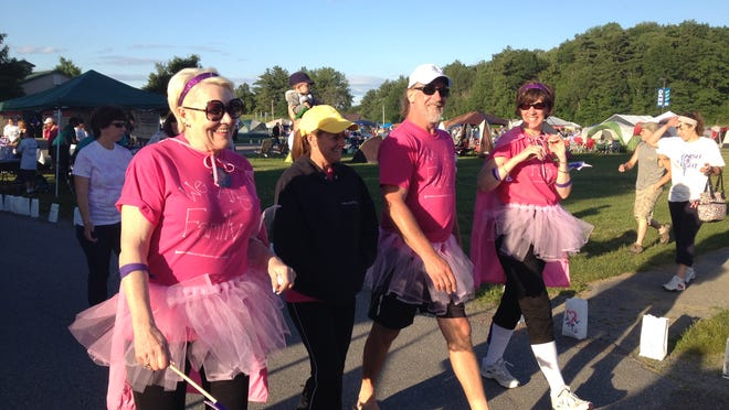 Members of the We Are Family team wear tutus during the Relay For Life in Essex Junction.