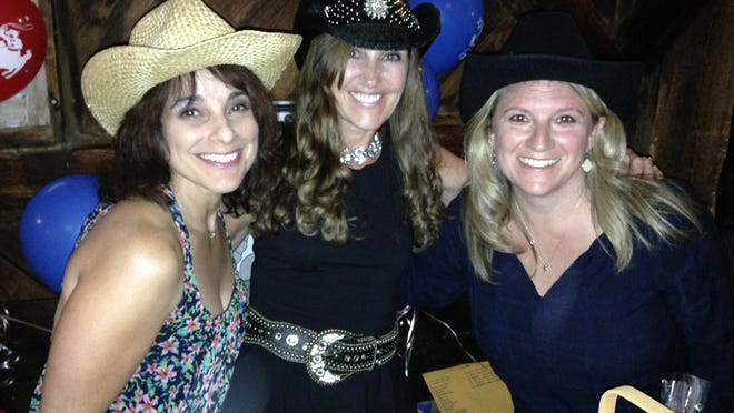 Abbey Kelley, Shelley Spillane and Karen Bresnahan at Friday's Cattle Baron's Ball in Charlotte.
