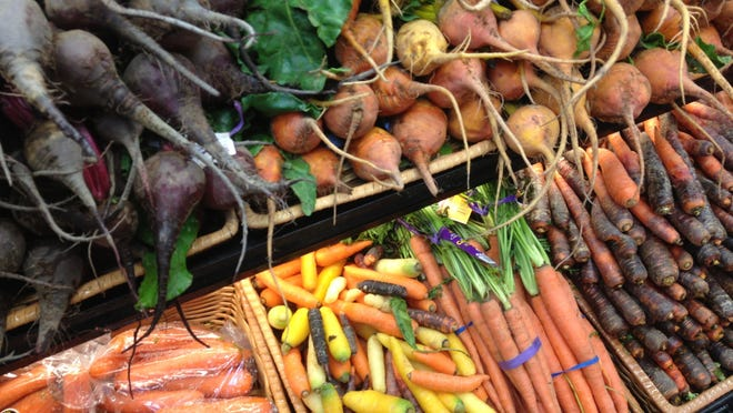 A display of colorful root vegetables at the Jericho Settlers Farm booth at a recent Burlington Farmers Market.