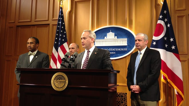 Senate President Keith Faber, R-Celina, discusses a bipartisan agreement on a plan to overhaul how Ohio draws its statehouse district lines at a news conference early Dec. 12. Also shown are, from left, Rep. Vernon Sykes, D-Akron; Senate Minority Leader Joe Schiavoni, D-Boardman; and Rep. Matt Huffman, R-Lima.