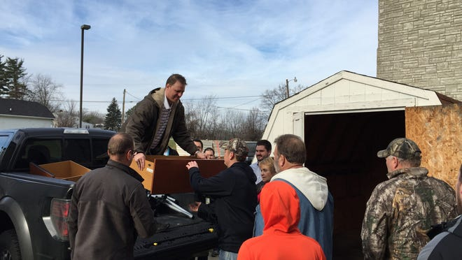 Legion Logistics employee Adam Praiswater helps unload donated furniture at New Haven Elementary in Union.