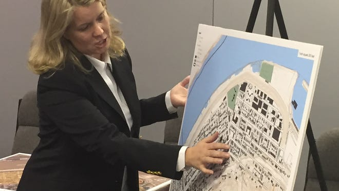 Dayton resident Catherine Hamilton Hicks discusses possible locations for a pier at a public meeting held Wednesday night in Dayton.