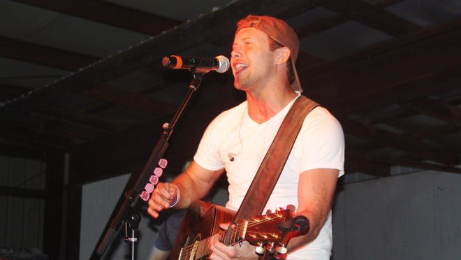 """A Coshocton native and Nashville resident, Casee Allen came home to shot a video for his first single release, """"A Shot of You."""" The event also served as a fundraiser to make needed improvements to the 4-H horse barn at the fairgrounds."""