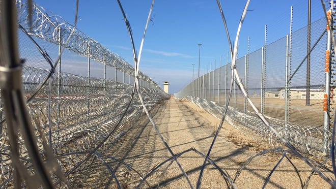 The new state prison at Fort Madison is surrounded by a double fence that is electrified and bolstered with razor wire to discourage escape attempts.