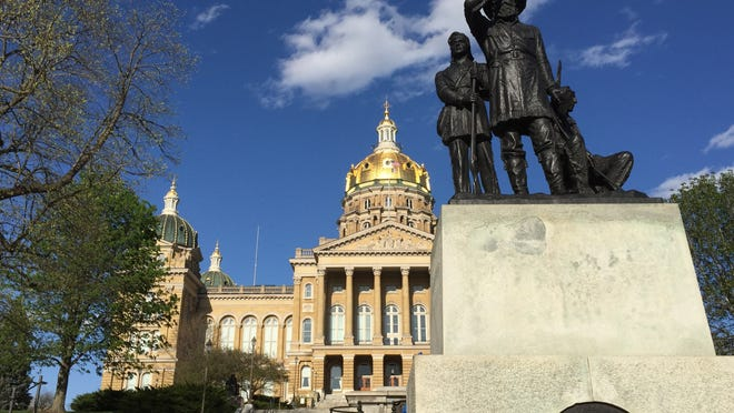 "A statue known as ""Pioneers of the Territory"" overlooks the west terrace of the Iowa Capitol."