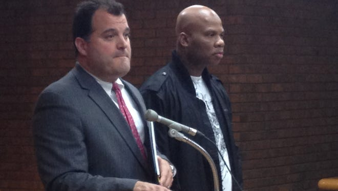 Former Oakland County Sheriff's Deputy Garry Jackson, right, stands with his lawyer Steve Vitale on Sept. 16, 2013.