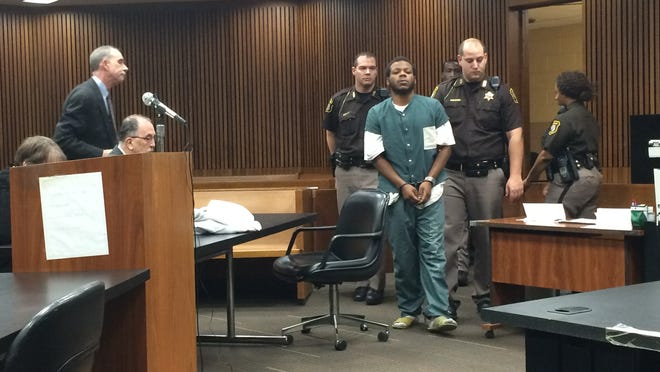 Dwayne Sharper, Jr., 19, enters Wayne County Third Circuit Court for arraignment Dec. 29  on charges connected to the shooting death of a 16-year-old Detroit boy.