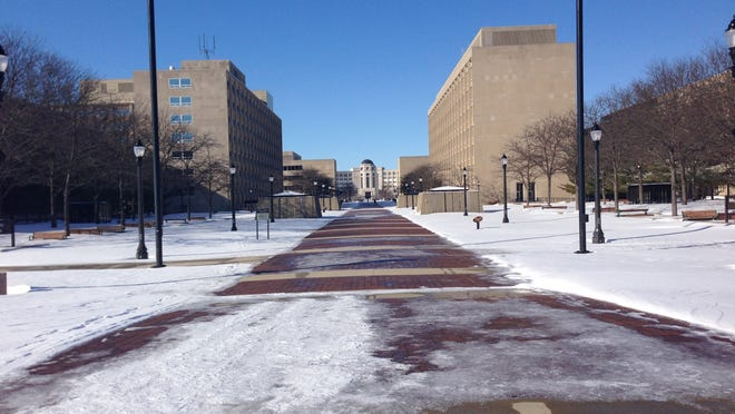 A walkway leading from six state office buildings to the state Capitol remained mostly snow-free Monday morning, despite more than a foot of snow falling in Lansing Sunday, because of the heated walkway installed several years ago at a cost of $6.5 million.