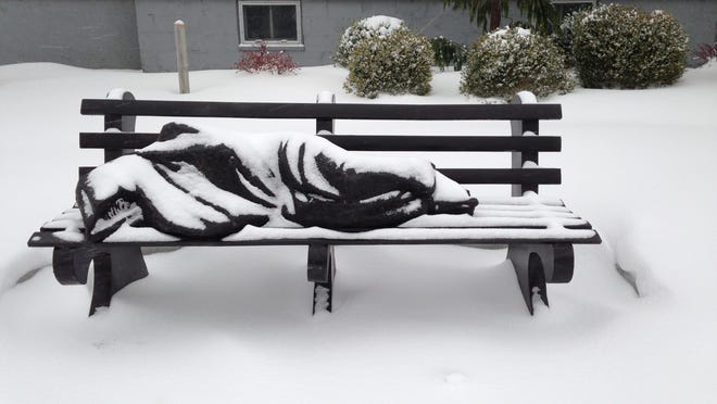 """A """"Homeless Jesus"""" sculpture sits in front of St. John's Episcopal Church in Grand Haven."""