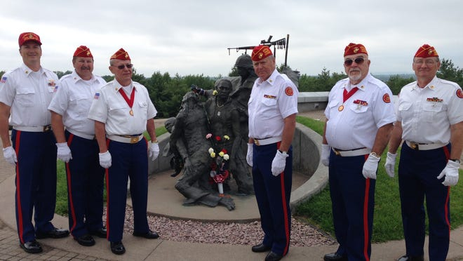 Members of the Fond du Lac Marine Corps League are shown at the Highground Veterans Memorial Park. From left, Richard Feustel, Scott Nehls, Mike Gannon, John Laudolff, William Drexel and Owen Braatz.