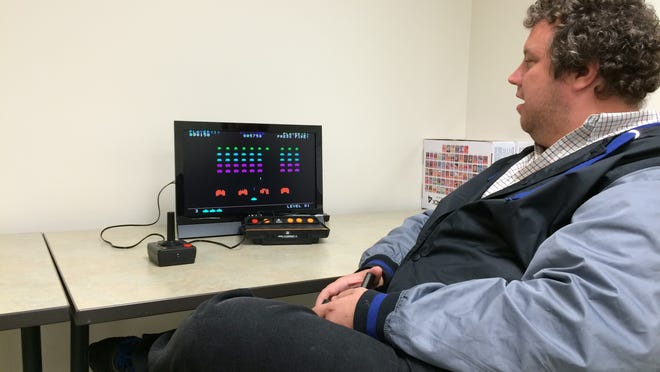 "Robert Kiepert Jr. of Fond du Lac plays ""Space Invaders"" at the Home Video Arcade Experience at the Fond du Lac Public Library."
