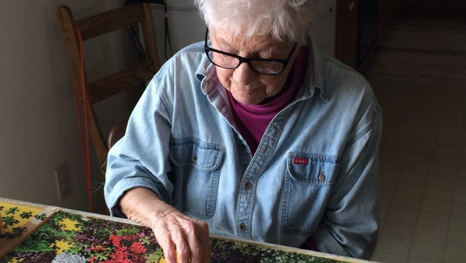 Those who suffer from uncontrollable shaking of their hand due to essential tremor often employ adaptive strategies to minimize the consequences of the tremor. Delores Rozek, 87, of Fond du Lac, constructed a special puzzle frame to keep the puzzle pieces on the table in spite of her shaking hands.