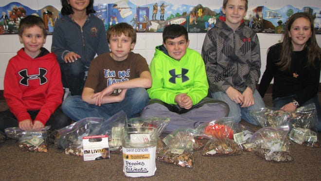 Over a five-year period students at Friendship Learning Center in North Fond du Lac have collected more than $16,000 to fight From left are Esther Jung, Nicholas Cohen, Nolan Stark, Isaac Gilbertson, Karson Gindt and Jamie Catania.