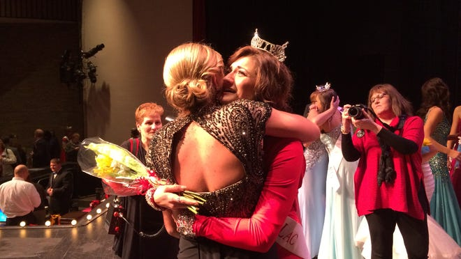 Newly crowned Miss Fond du Lac 2015 McCayla Thoe, right, hugs outgoing Miss Fond du Lac 2014 Malainey Myrin on Saturday night, March 14 at Goodrich Little Theatre in Fond du Lac.