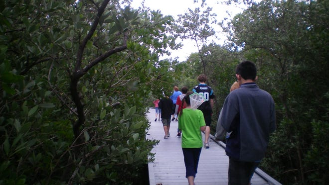 Visitors walk on one of the nature trails at Rotary Park in Cape Coral.