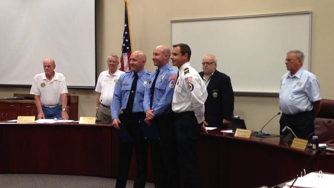 Bonita Springs Firefighter Paramedics Jonathan Whitlock and Brian Hornberger received the Phoenix Award, the district's highest honor, from Chief Joe Daigle for reviving a man who went into cardiac arrest.