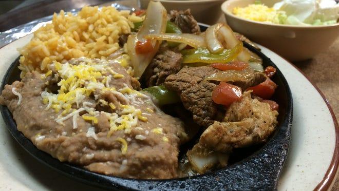 Steak and chicken fajitas are a hot dish from Perico's in Cape Coral.