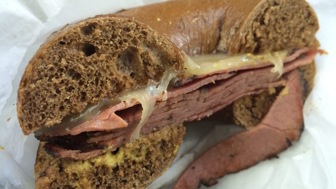A pumpernickel bagel with pastrami and Swiss cheese from Stuff-A-Bagel in Cape Coral.