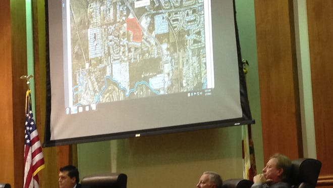 Lee County Commissioners Brian Hamman, Frank Mann and Larry Kiker listen to Estero residents speak about rezoning changes for Estero Grande on Wednesday. The Commission voted 4-1 to approve the mixed-use project.