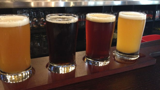 The Brass Tap offers a full menu and 70 beers on tap plus more than 100 beers in a bottle.