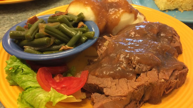 Pot roast with mashed potatoes, bacon-flecked green beans and corn bread costs $8.99 at Jax Diner, a breakfast-lunch place in North Fort Myers.