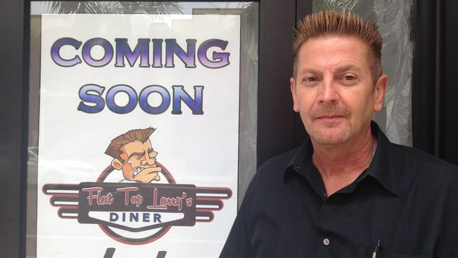 Co-owner Larry Lare poses outside of Flat Top Larry's in downtown Fort Myers
