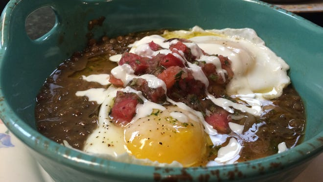 The Lentil Organic Bowl from Mermaid Garden Cafe features organic eggs over fresh roasted lentils with salsa and savory cream.