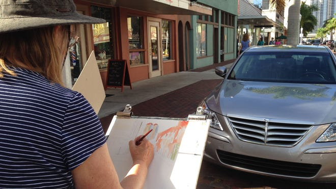 Sheila Wissner of Cape Coral paints First Street and the high-rise towers in the background in downtown Fort Myers during a meeting of the Lee Plein Air Group.