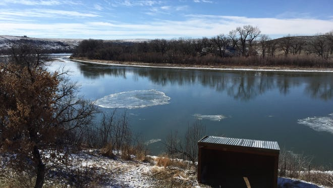 A plate of ice floats downstream on the Missouri River just upstream from Great Falls on Tuesday.