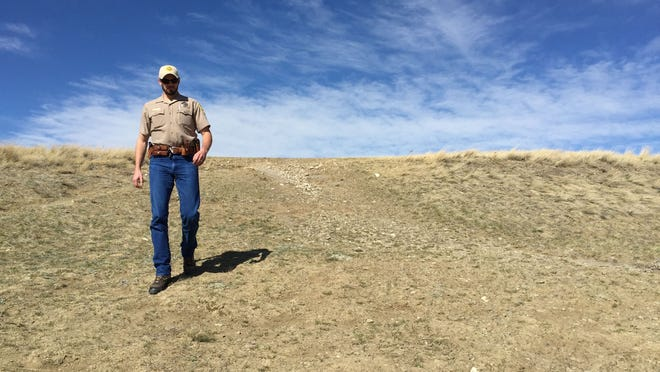 Game warden Brett Logan of Montana Fish, Wildlife and Parks, does a foot patrol at First Peoples Buffalo Jump near Ulm.