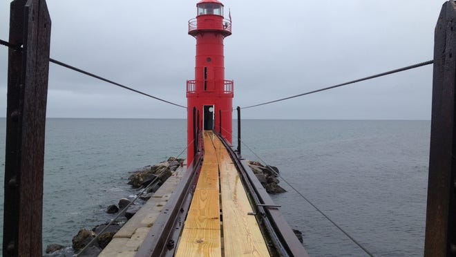 The precarious wood-and-steel platform to the lighthouse.