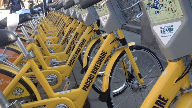 About 20 bikes that are part of the city's new Pacers Bikeshare program sit outside Bankers Life Fieldhouse before a kick-off press conferenceon Tuesday.