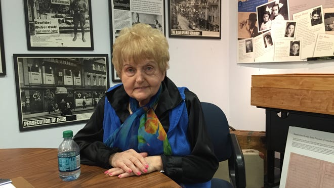 Auschwitz survivor Eva Kor in the Holocaust museum she operates in Terre Haute. She will attend ceremonies marking the 70th anniversary of the liberation of Auschwitz on Tuesday in Poland.